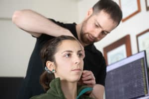 Woman doing neurofeedback training with Dr David Helfand PsyD