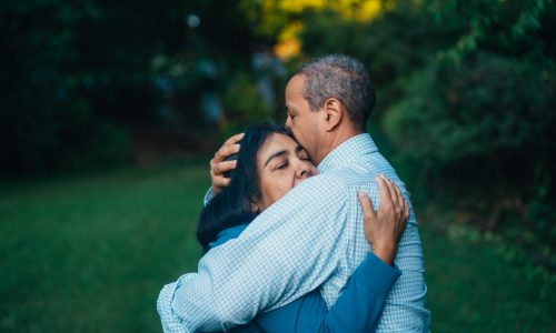 couple hugging to improve emotional intimacy